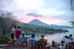 AGUNG VOLCANO: WHAT'S UP? Puri Dajuma, Beach Eco-Resort & Spa, West Bali Photograph: Juni Kriswanto/AFP/Getty Images